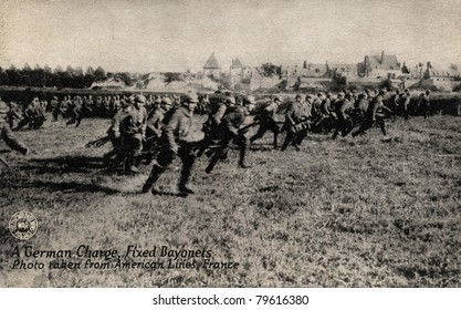 A German Charge, Fixed Bayonet - Early 1900's WWI postcard depicting American soldiers on front lines charging Germans with bayonets while in France.