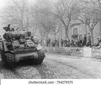 German children watch U.S. Tanks of 87th Division, Third U.S. Army, enter town of Kobern, Germany. March 16, 1945. Kobern, was on the Moselle River five miles southwest of Coblenz. World War 2