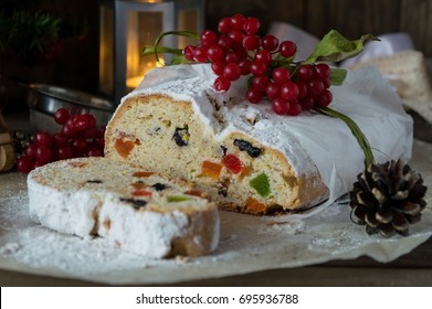 German Christmas baked goods - stollen, baked from germany with candied fruits, nuts and rum in powdered sugar