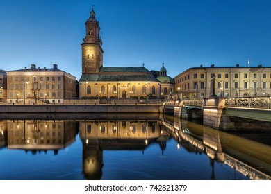 German Church (Christinae Church) reflecting in water of Big Harbor Canal at dusk in Gothenburg, Sweden