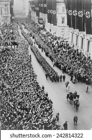 German crowds saluting during a Berlin military parade celebrating the Anschluss, the German Annexation of Austria in 1938.