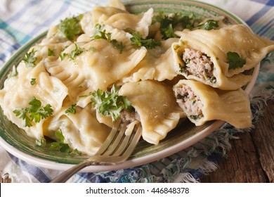 German cuisine: Dumplings Maultaschen with spinach and meat close up on a plate. horizontal