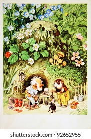 GERMAN DEMOCRATIC REPUBLIC - CIRCA 1954: Reproduction of antique postcard shows Gnome front of his house with a mouse and beetle, circa 1954
