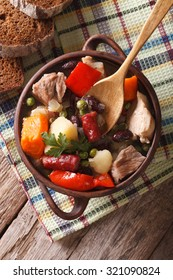 German eintopf soup with meat and vegetables on a table close-up vertical view from above