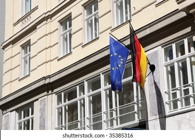 A German and European Flag mounted on a building