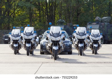 german feldjaeger, military police motorcycles and vehicles stands in formation