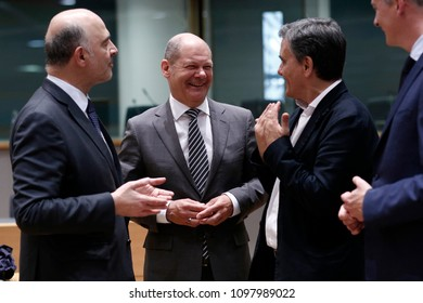 German finance minister, Olaf Scholz  arrives to attend in an Eurogroup finance ministers meeting at the European Council in Brussels, Belgium on May 24, 2018.