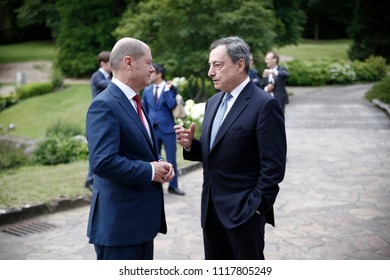 German Finance Minister Olaf Scholz talks with ECB President Mario Draghi during a Eurogroup meeting at Senningen Castle in Luxembourg on June 21, 2018