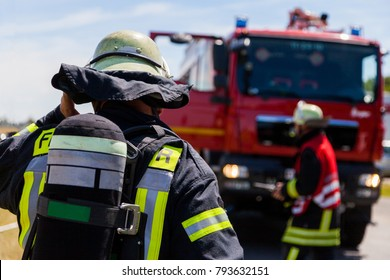 german fireman ( Feuerwehr ) stands near an accident