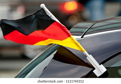 German flag blowing in the wind on a driving car