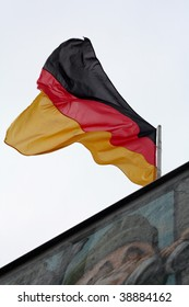 The German flag flying over the Berlin Wall