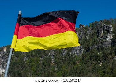 German Flag and National Park of Saxon Switzerland in eastern Germany, south-east of Dresden. Beautiful ladscape view in germany, europe. Popular destination for treking and other outdoor activities
