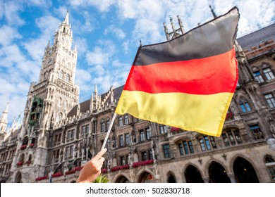 German flag on the town hall building background in Munich
