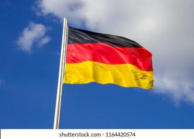 German Flag Waving in Blue Sky
