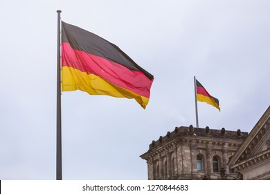 german flags waving near the german reichtstag