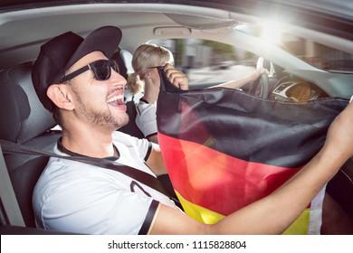 German football fan inside a car