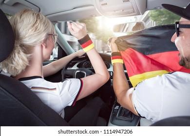German football fans inside a car