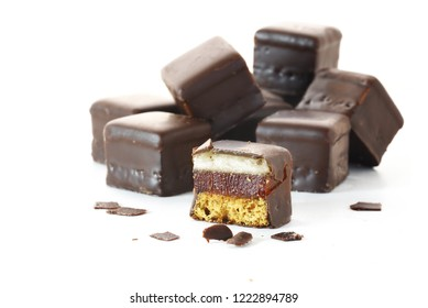 German gingerbread with cherry jelly and marzipan in chocolate called Dominosteine, pastry for christmas and advent, isolated on a white background