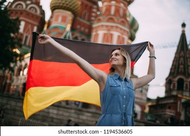 German girl in Russia. German waving a flag. Middle shot. Sunny