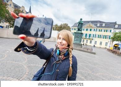 German Girl Taking Selfie in Bonn Main Square