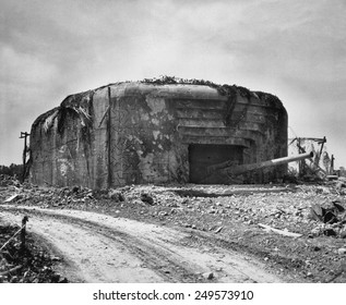 German gun emplacement had concrete walls 13 feet thick and four 10 1/4 inch guns. This position was taken out of action by Allied aerial bombing. June 1944 World War 2.