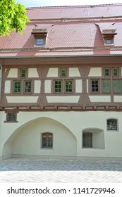 German half timbered building in medieval town with flag stone streets in the Swabian Jura region