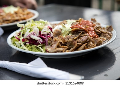 German Döner Kebab dish with veal, salad and hot sauce