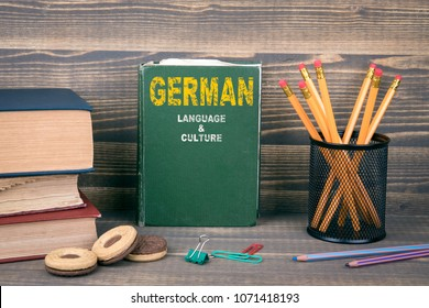 German language and culture concept. Book on a wooden background