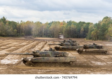 german main battle tanks drives on battlefield