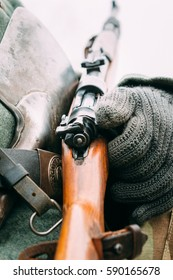 German Mauser carbine 98k in the hands of a soldier. Reconstruction. Close-up