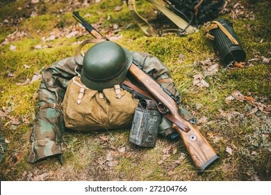 German military ammunition of World War II on ground. Military helmet, lights, rifle Mauser Karabiner 98k