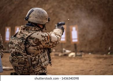German military training with pistols, rifles, and machine guns.