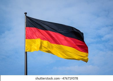 German national flag in against blue sky