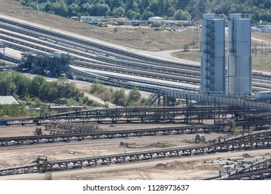 German open pit mine with conveyor belts transporting brown coal to power plants