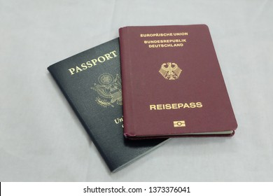 German passport, and American passport with white background.