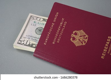 German passport full of money ready for travel