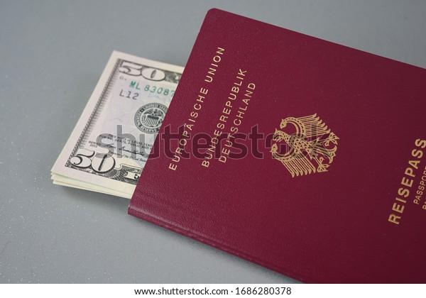German passport full of money ready for travel