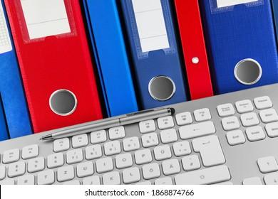 German PC keyboard and file folders