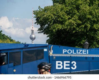 German Police Car in foreground of Berlin Fernsehturm