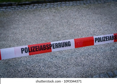 German police cordoning off, with the German words for police cordon