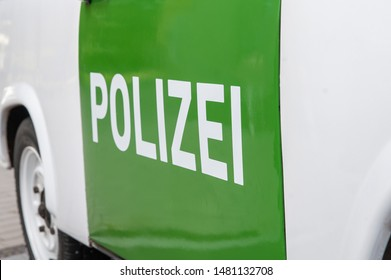 German police label on police car (on green background).