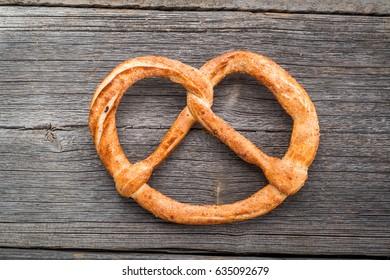 German pretzels on wooden table. Crisp bread from wheat