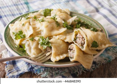 German ravioli Maultaschen with spinach and meat close up on a plate. horizontal