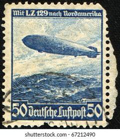 German Reich - CIRCA 1936: Airmail Stamp printed in German Reich shows Zeppelin LZ 129 Hindenburg above North America