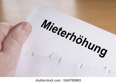 Mieterhöhung is German for rent increase, hand holding letter