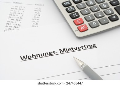 german rental agreement - Mietvertrag Wohnung - in german with calculator and pen