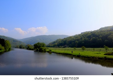 German river Lahn in spring. Countryside landscape with hills and dales.