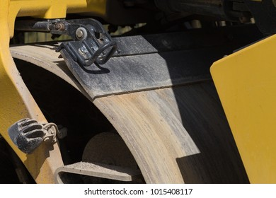 german roadroller parts and details in black and yellow colors on a sunny day in june at south germany
