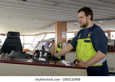 A German sailor at the helm of a ship