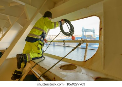 German sailor mooring the ship
